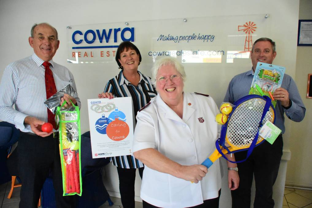 Cowra Mayor, Councillor Bill West and Major Louise Nicholson (front) with Cowra Real Estate principals Lyn Sharkey and Stephen Haslam.